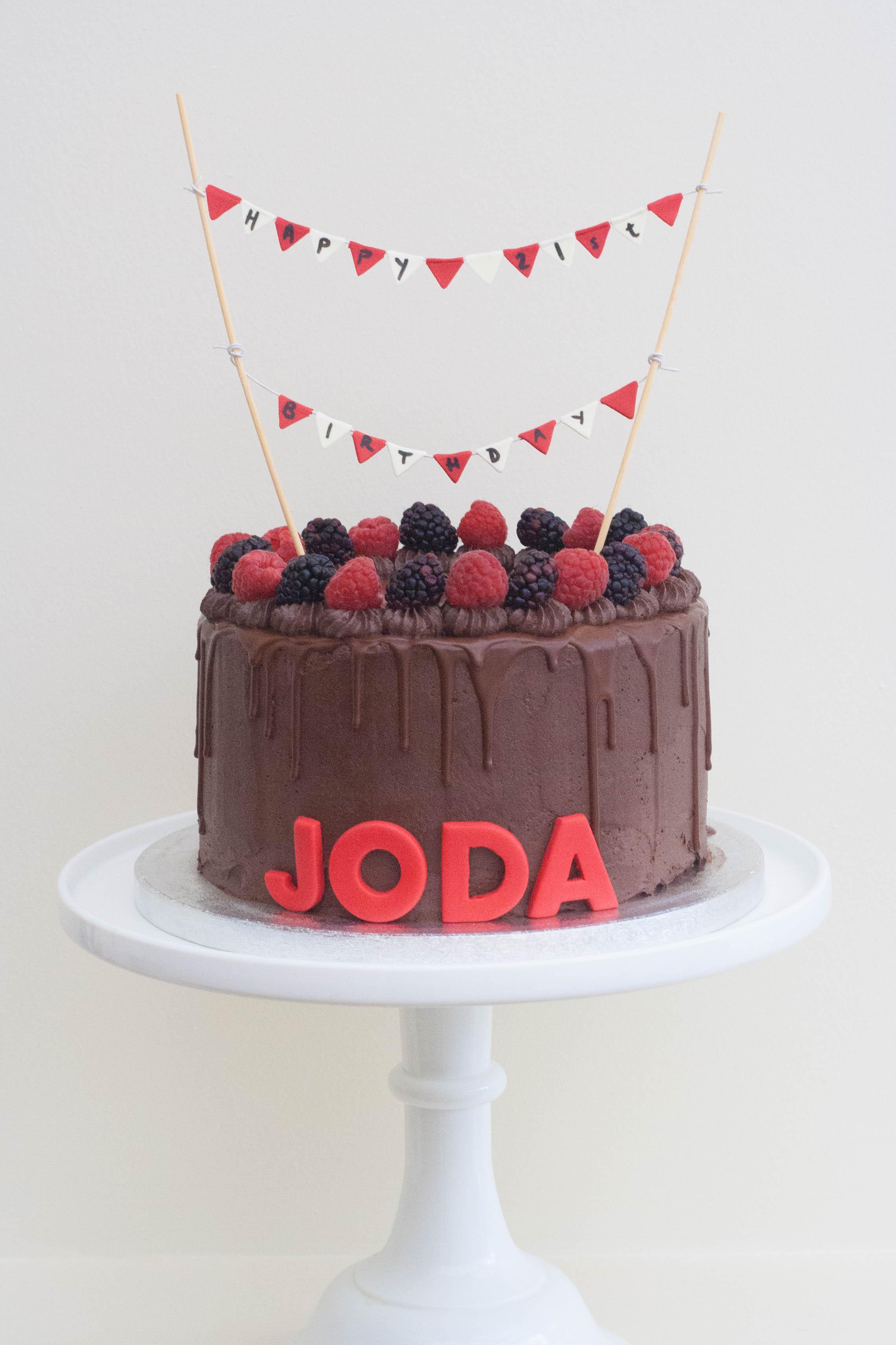 chocolate raspberry blackberry vegan drip cake bunting