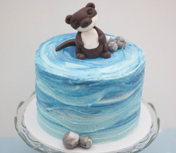 otter blue frosted watercolour cake vega