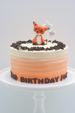 orange ombre crushed Oreo fox cake