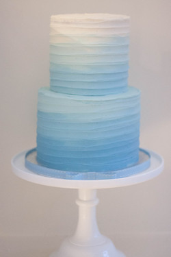 blue ombre tall two tier christening cak