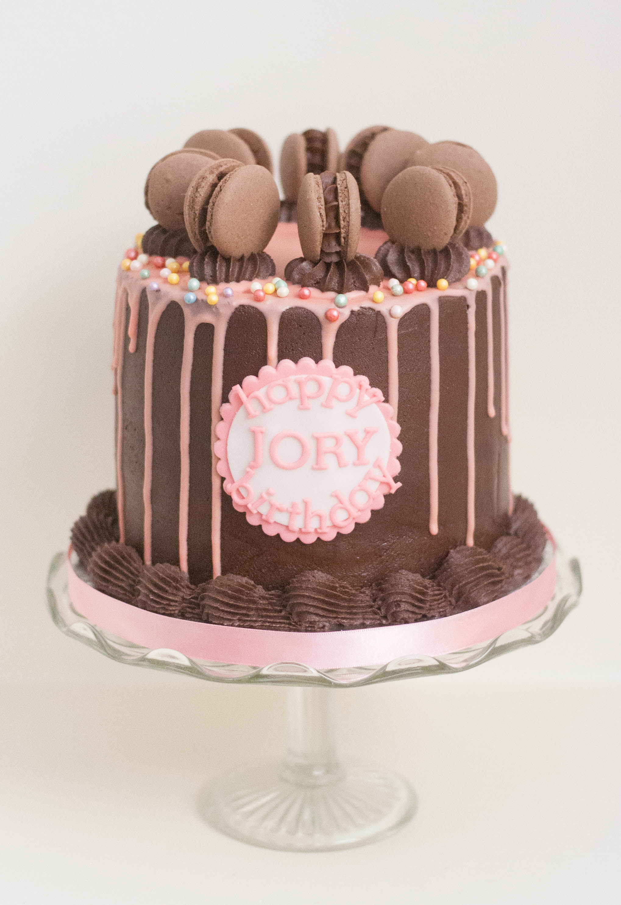 choc macaron pink drip vegan cake