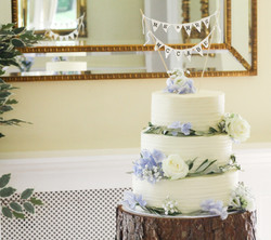 three tier frosted wedding cake