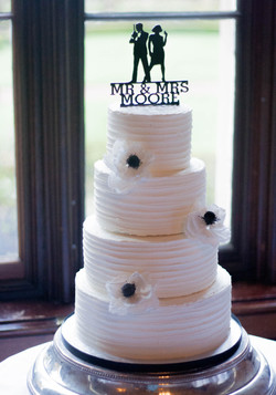 four tier frosted vegan wedding cake ane