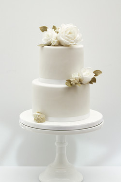 two tier wedding cake white roses olive