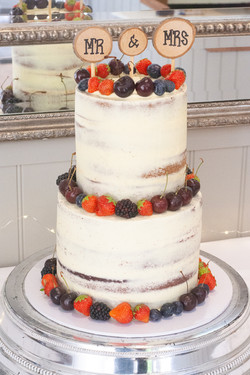 tall two tier semi naked wedding cake