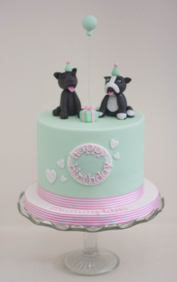 two dogs pale green vegan birthday cake.