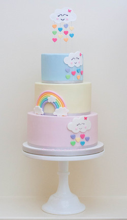 three tier vegan cloud rainbow cake for