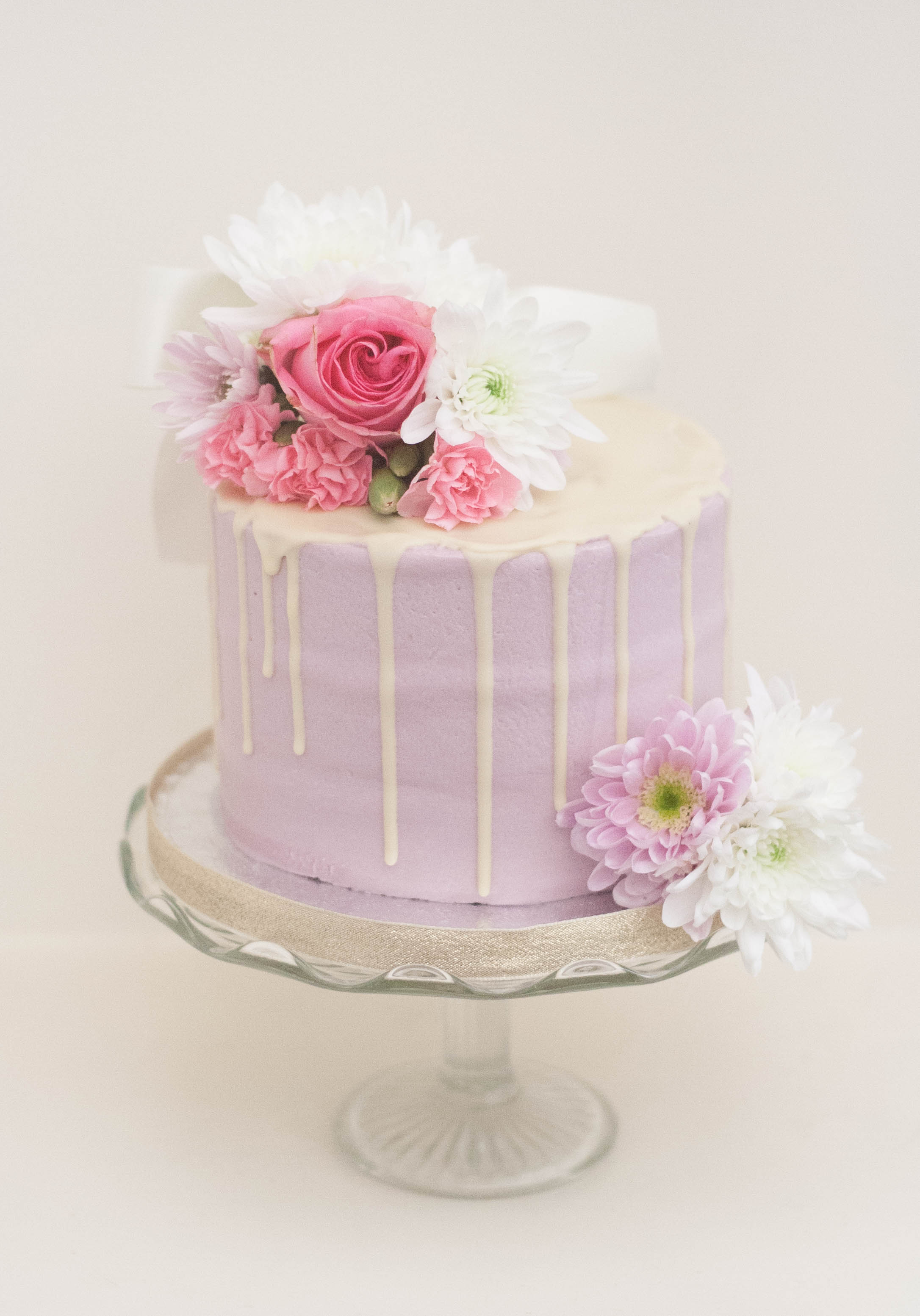 lilac frosted vegan cake fresh flowers