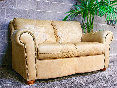 Genuine Leather Studded Sleigh Loveseat