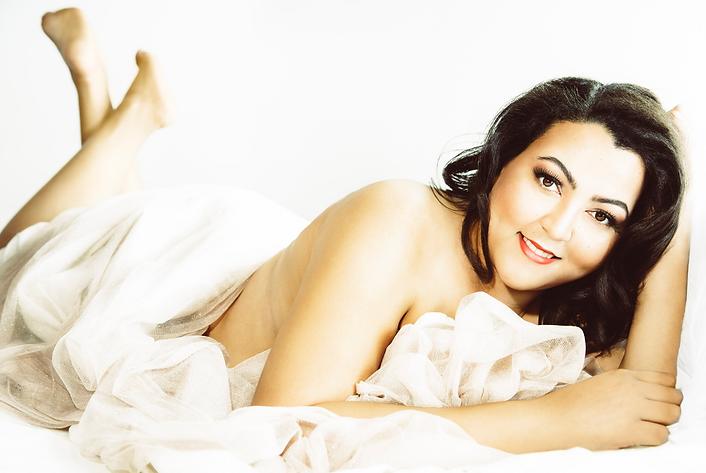 women's naked body covered ina white sheet