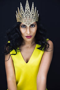 women in a yellow dress and gold crown portrait photography