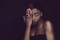 Portrait photography of women with gold ring taken at Vilija Skubute studio