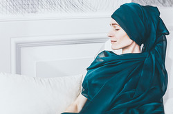 Portrait photography of women wrapped in green scarf taken at Vilija Skubute Studio