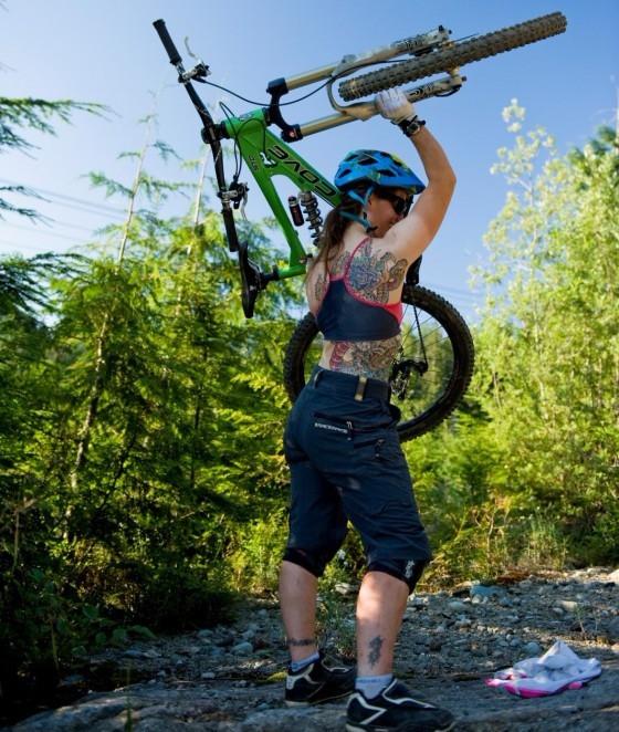 Mountain bike cove held above head