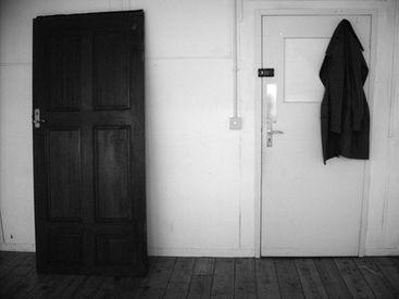 "<img src=""http://www.abstracthouse.org/#!contact-1/jql81.jpg""""height""=""3750""x ""width""=""5000"" ""sculptor Darren O'Connor coat hanging, upside down door"" ""untitled sculpture"" />"