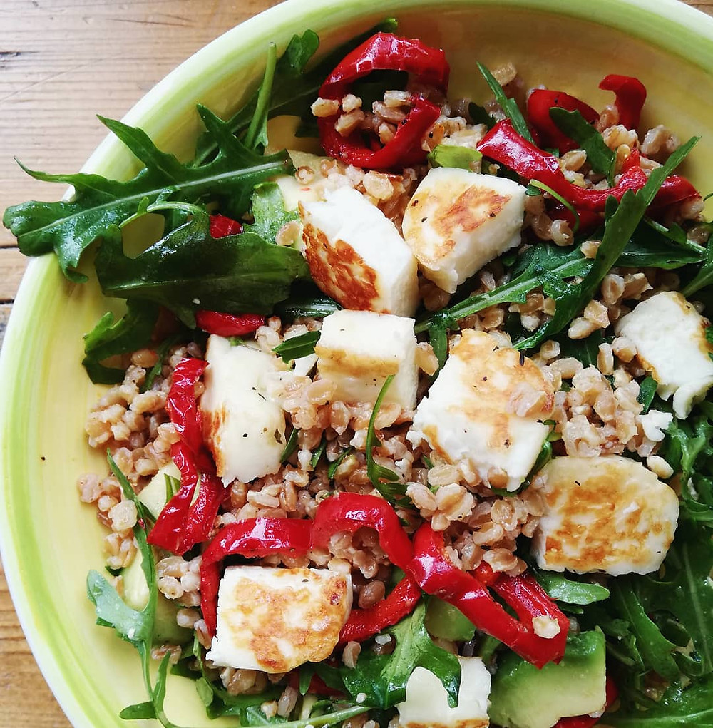 Pearled spelt salad with halloumi, avocado and roasted red peppers