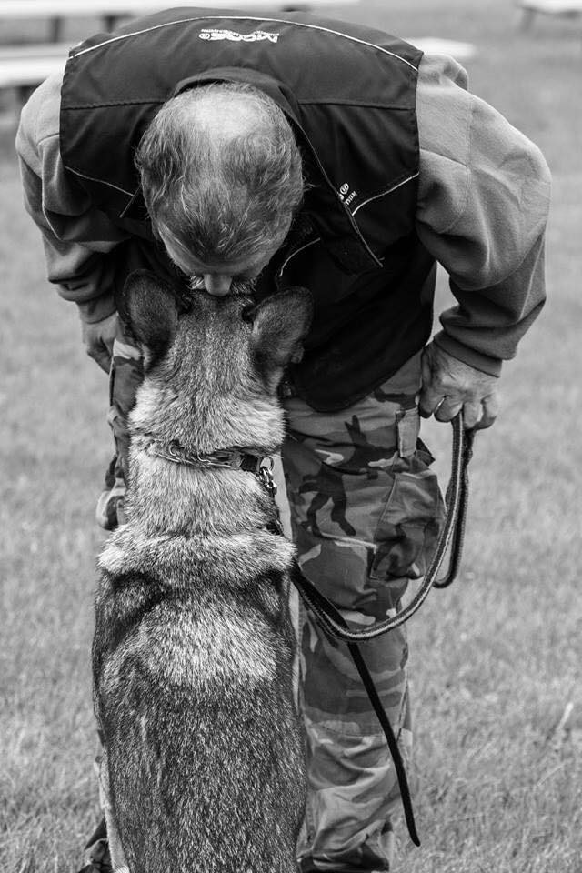 Don't neglect the human element of motivation! Photo: Handler Albert Rinow bestows affection on his dog. Photo by: Peter Qi.