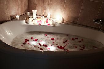 Butler Rose petal bath with candles