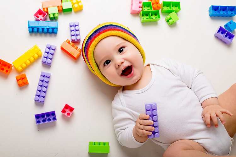 baby-boy-playing-with-multi-colored-cons