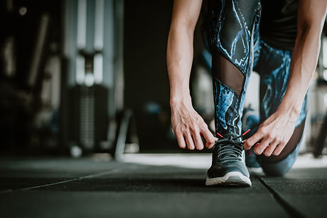 woman-tying-her-shoelaces-before-exercis