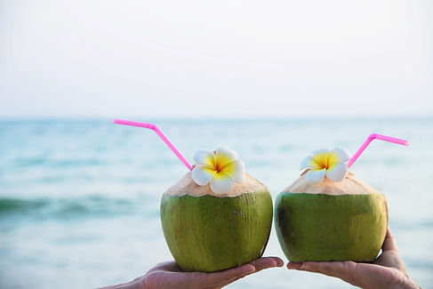 fresh-coconut-in-couple-hands-with-plume