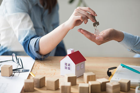 close-up-woman-s-hand-giving-house-key-m