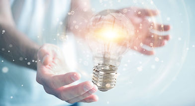 businessman-connecting-modern-lightbulbs