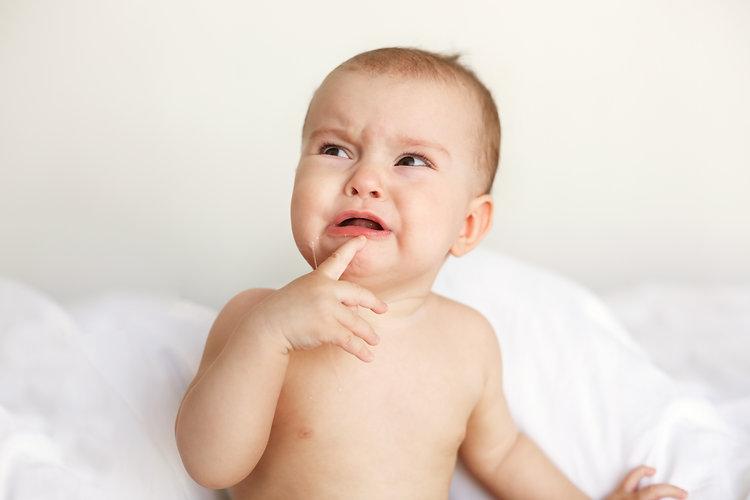 cute-nice-little-baby-woman-crying-lying