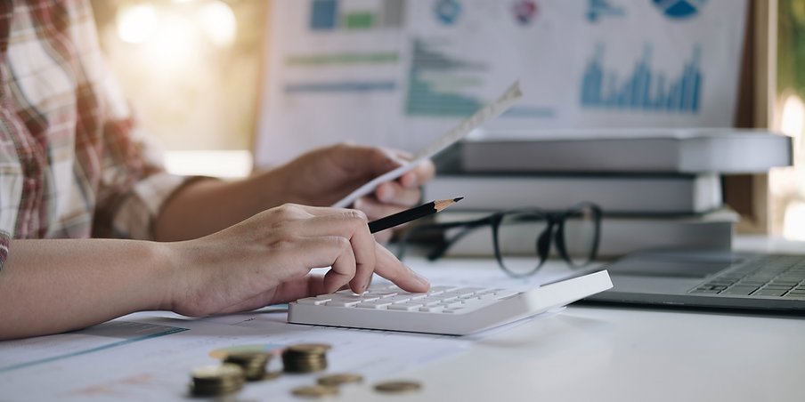 financial-data-analyzing-hand-writing-counting-calculator-office-wood-desk.jpg