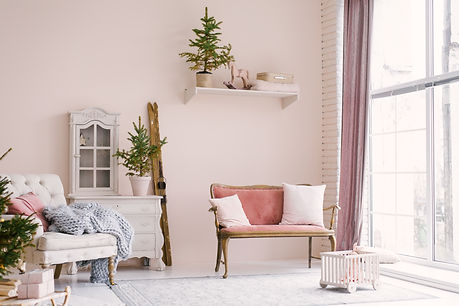 pink-vintage-sofa-with-pillows-stands-ne