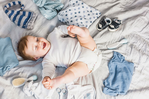 top-view-blonde-baby-surrounded-by-cloth