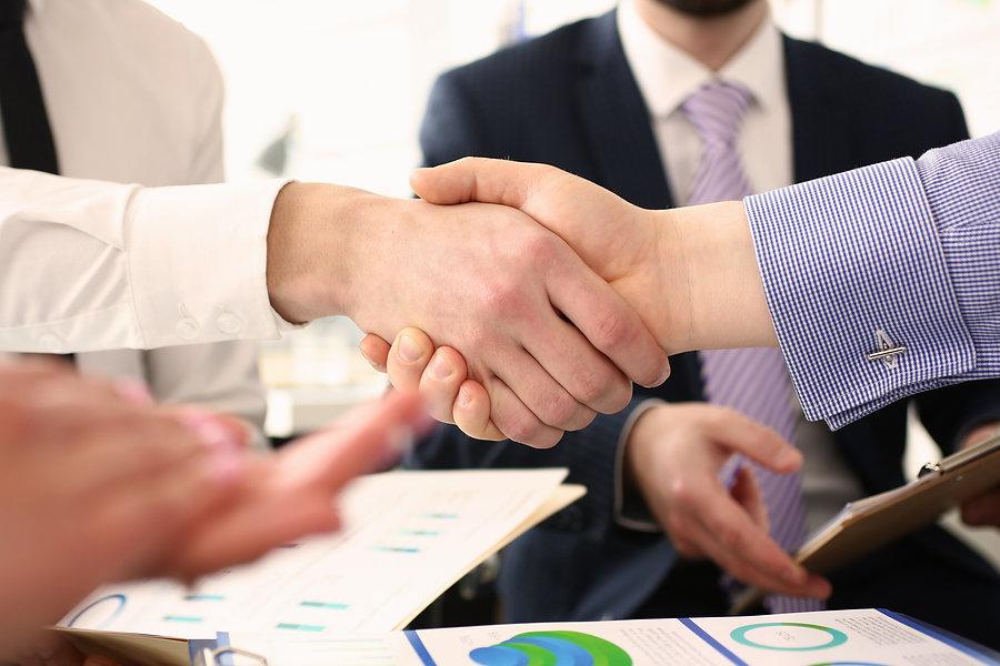 group-businessmen-shaking-hands-after-pr