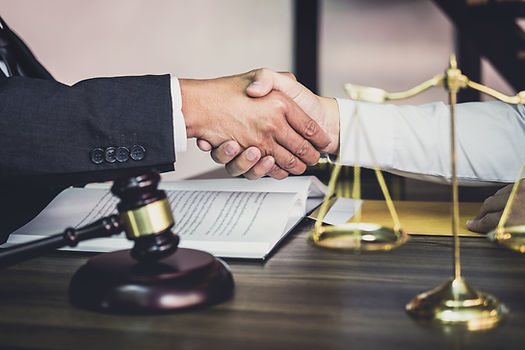 businessman-handshake-with-male-lawyer-a