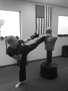 Krav Maga instructor in Ocala demonstrates a head kick