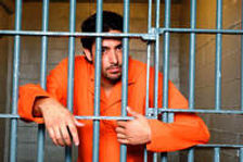prisoner-behind-bars_1.jpg
