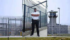 GUARD IN FRONT OF PRISON.jpg