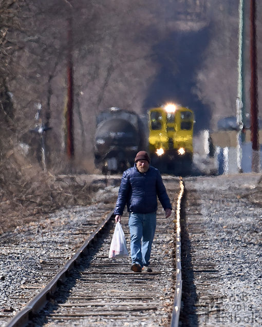 North Shore Railroad train in Bloomsburg, Pa.,approaches a trespassing pedestrian, Operation Lifesaver