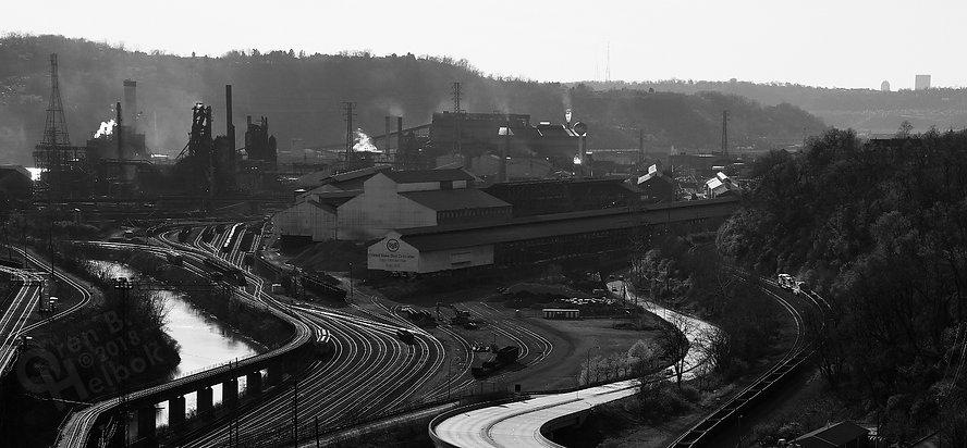 Westbound Norfolk Southern empty hopper train passing the U.S. Steel Edgar Thompson Works, seen from the George Westinghouse Bridge