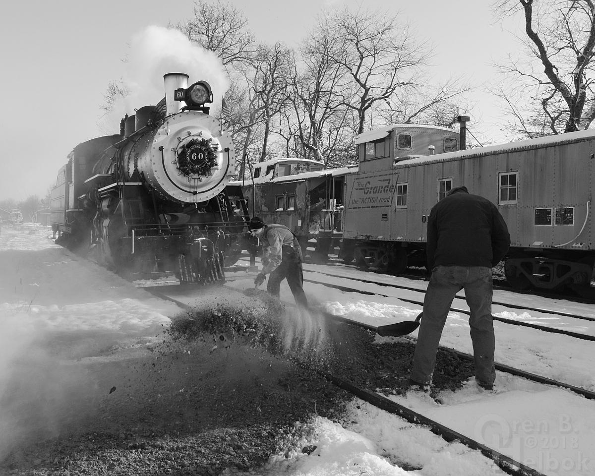 Engine crew shoveling ash
