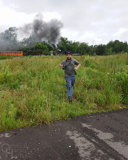 Arcade & Attica Railroad #18 northbound with railfan photographer