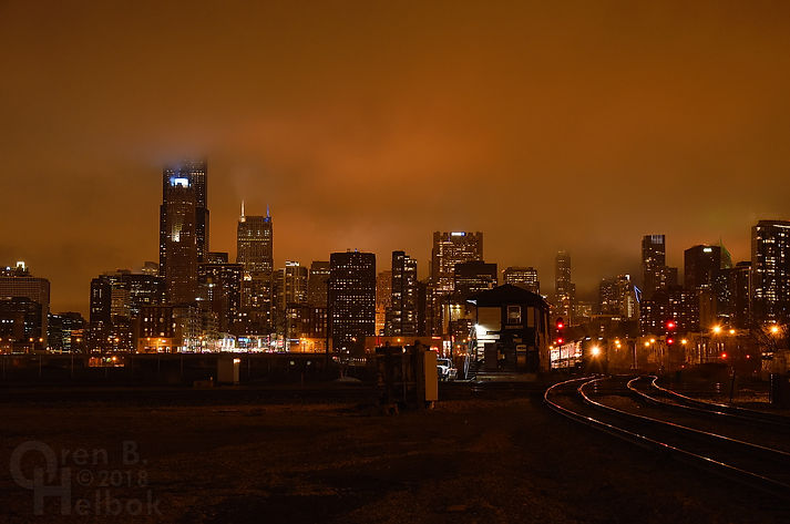 Metra 16th Street Tower, Chicago, outbound Rock Island District train, Chicago skyline at night