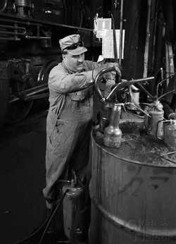 Chris LaBar filling oil can