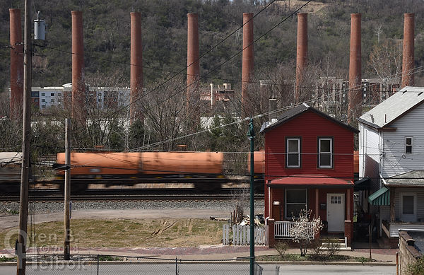 Westbound Norfolk Southern freight passing Homestead Works smokestacks, Homestead, Pa.