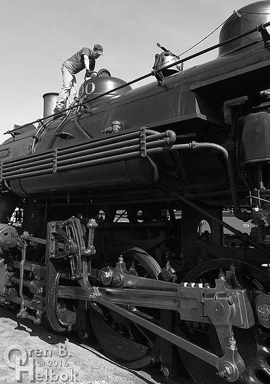 Strasburg Rail Road engineer Darin Esterly checking #90's sandbox