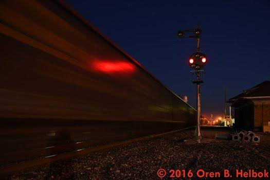 "Southbound CSX freight and B&O color-position-light signal, ""Crossroads of the B. & O."", Deshler, Ohio, Oren B. Helbok photo"