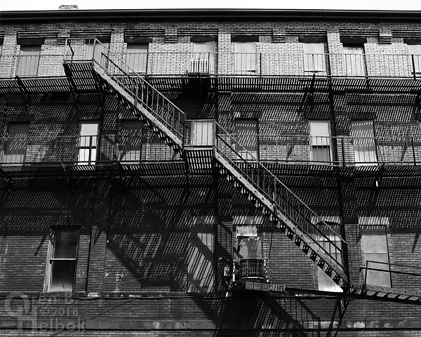 Fire escapes and shadows on Howard Street, Homestead, Pa.