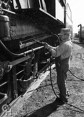 Strasburg Rail Road fireman Earl Knoob cleaning #90's ashpan