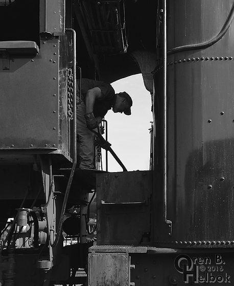 Strasburg Rail Road engineer Darin Esterly shoveling coal into #90