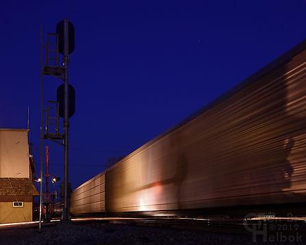 Dusk, Iron Triangle, Fostoria, Ohio, NS and CSX diamonds, eastbound NS freight train, Oren B. Helbok photo
