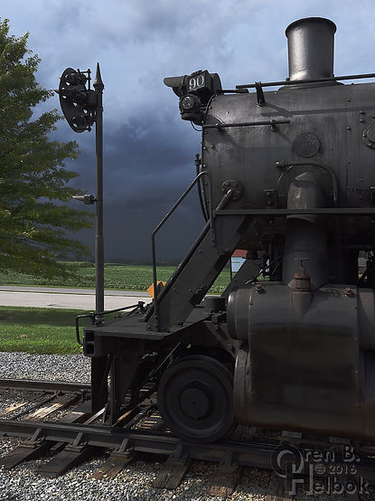 Strasburg Rail Road #90 under storm clouds at the Pennsy signal on East Strasburg station runaround